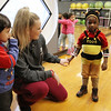 Afternoon dance party for pre-schoolers at the Greater Lowell YMCA. From left, Matthew Guzman, 3, of Lowell, teacher Casey Power, 18, and Rasheed Barrie, 3, of Lowell, in his favorite costume that he puts on every day. (SUN/Julia Malakie)