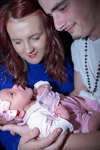 Macey Jaye Owen at one week old sharing a portrait session with her family.