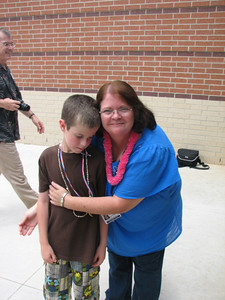 Tyler with Mrs. Robicheaux.  BOY did they form a special bond this year!  She has brought Tyler a long way with his communication abilities.