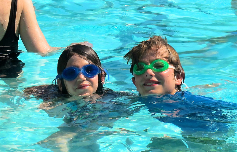The nice thing about a neighborhood pool is all the friends we run into...here's Sasha with his pal from school, Rachel.