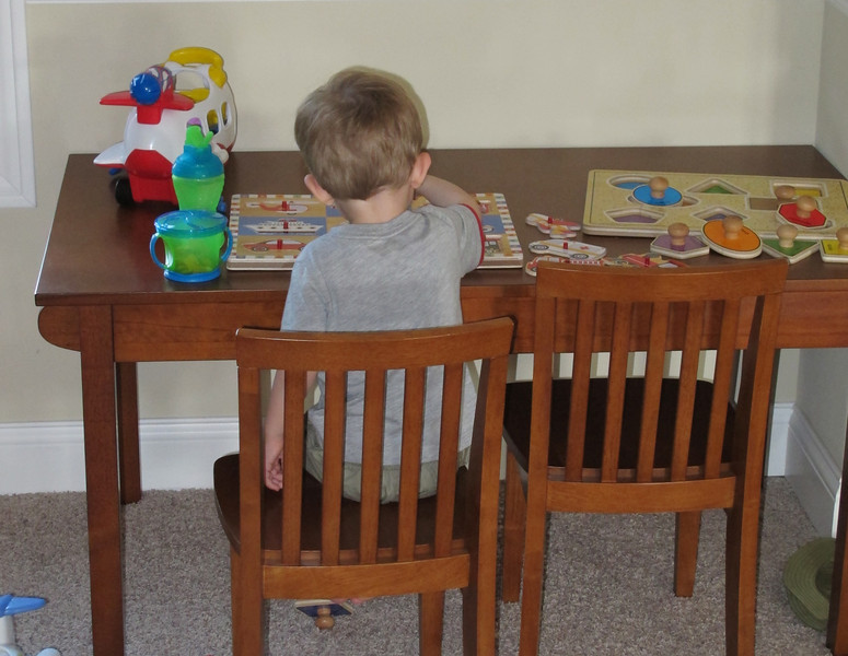 Early in the week, Chase got his snacks and drink and sat at his table and played with his puzzle.  It was really cute watching him get his stuff gathered and getting himself in the chair.