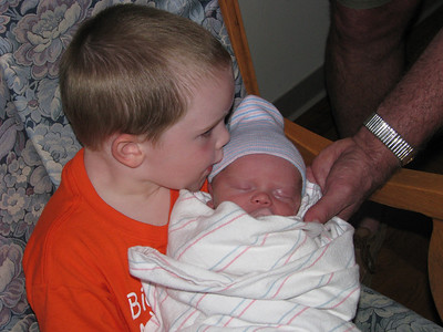Kissing his baby brother