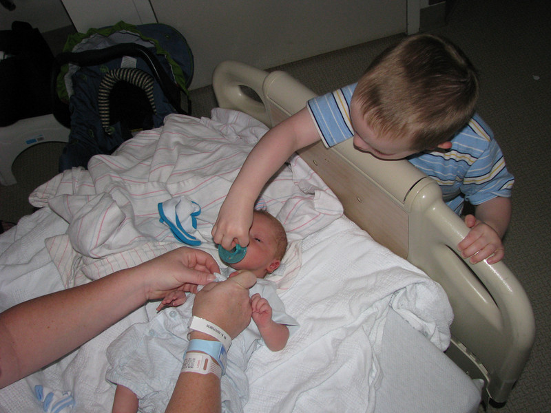 Big Brother Alex helping with pacifier