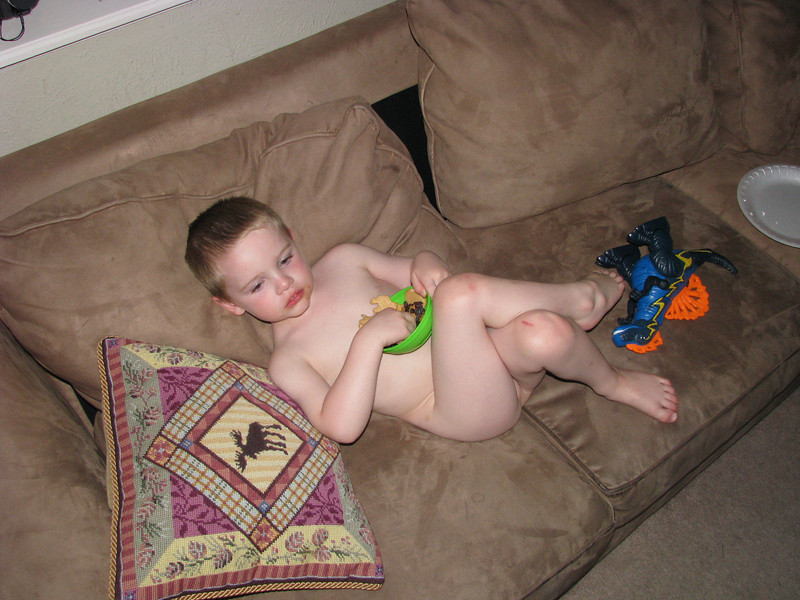 Just hanging out on the couch...wait, where are my clothes?