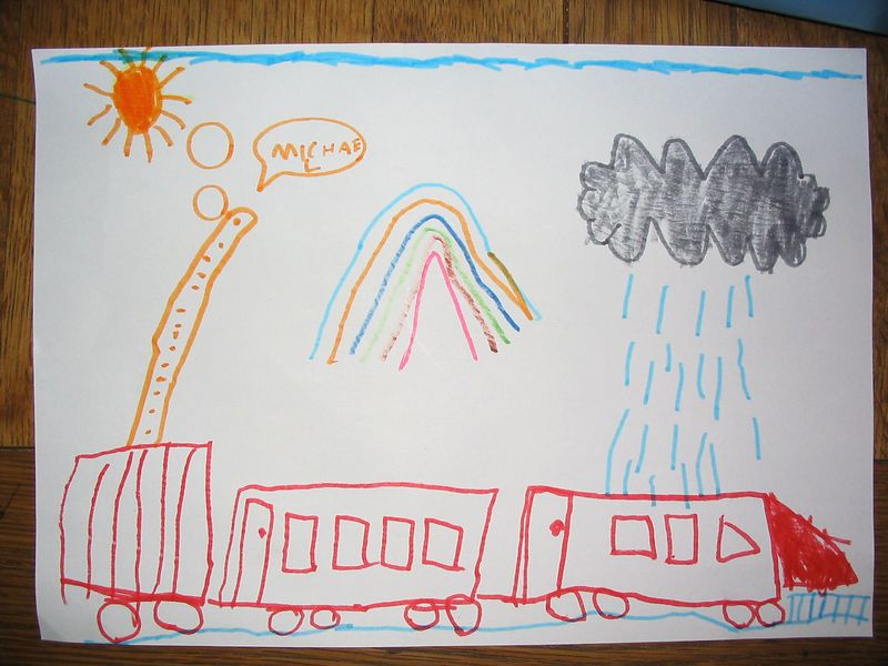 Circus train complete with Giraffe, and the weather today, sunny showers with rainbows Oct2003