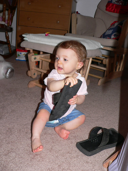 Neely discovers Auntie Nathan's sandals....and SHE LIKES!!!