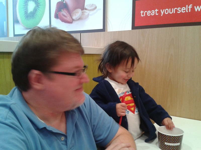 EJ enjoyed his vanilla yogurt with raspberries and cocoa krispies on top!