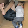 Like cats, toddlers love empty boxes too.  This box had a nightstand for Austin's room in it.