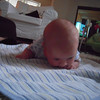 Tummy Time. No wonder it takes a lot of strength, that's a big head Cole!