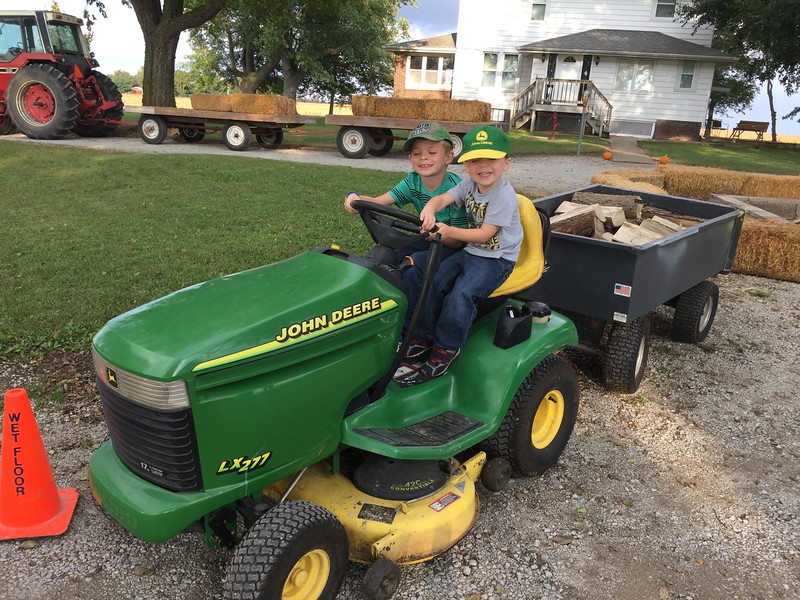 Playing with the JD lawn mower at the Maxheimer cookout.  Austin almost started it once.