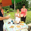 Ff Robert Penning talks with Debra Lambert mother of Olivia and Olivias Aunt Kate at the Lemonade stand.<br /> <br /> Photo Scott LaPrade