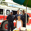 Olivia Lambert stands with Leominster Ff's L-R Eric Smith, Robert Griffin and Robert Penning.  Olivia has a lemonade stand rasing money for special NEADS dog.<br /> <br /> Photo Scott LaPrade