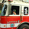Olivia sits in Ladder 1<br /> <br /> Photo Scott LaPrade