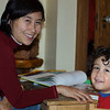 Mom and Jaden reading a book