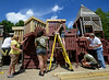 Members of the monty Tech JROTC and Alternatives Unlimited Inc work on restoring the play area at Ovila Case Playground on Stuart St in Gardner. SENTINEL&ENTERPRISE/ JIM MARABELLO
