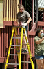 Sophomore Patricia Marabello of Gardner (on ladder) and Junior Brianna White of Fitchburg, both from Monty Tech JROTC work with Alternatives Unlimited Inc rehabing the play area at Ovila Case Playground on Stuart St in Gardner. SENTINEL&ENTERPRISE/ JIM MARABELLO