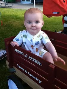 Theo enjoying his little red wagon.