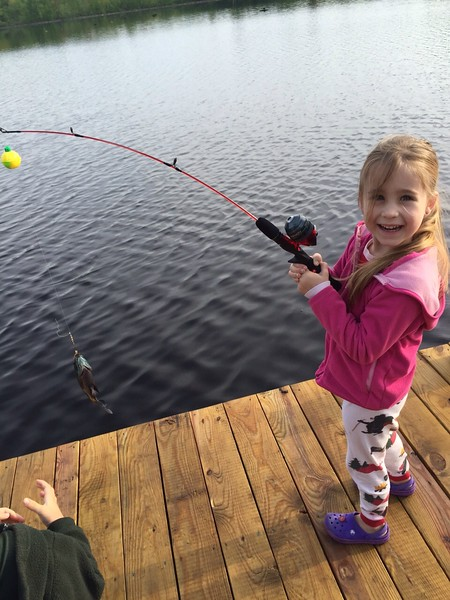 Caught her first fish camping with Daddy