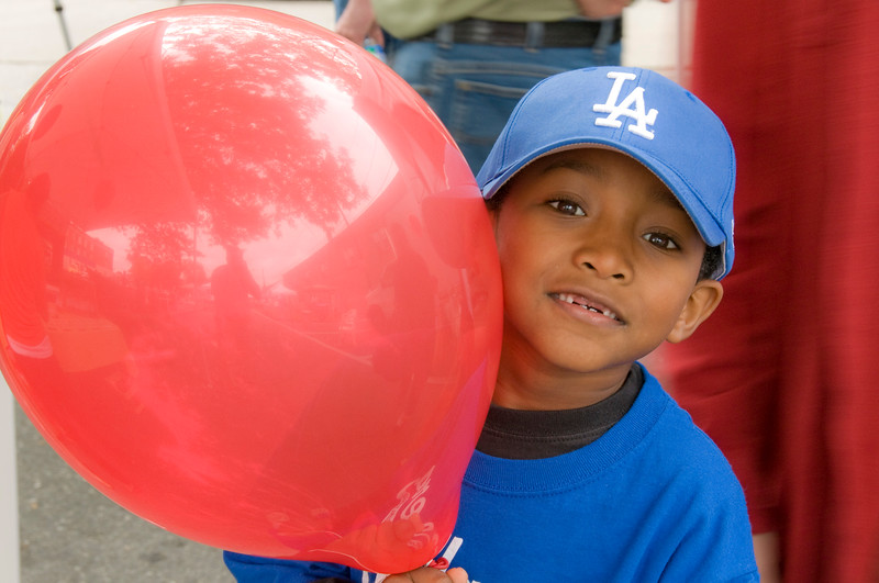 Blue Capped Boy with Red Balloon