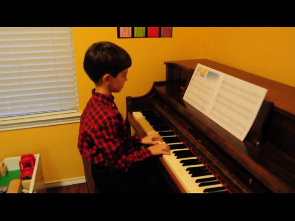 Kevin practicing for his first piano recital.  The songs were short, so he performed two songs.