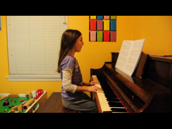 Katie practicing for her Christmas piano recital.  She is in her 3rd year taking piano.  It sounds a lot better on the teacher's piano because ours is really old and out of tune.