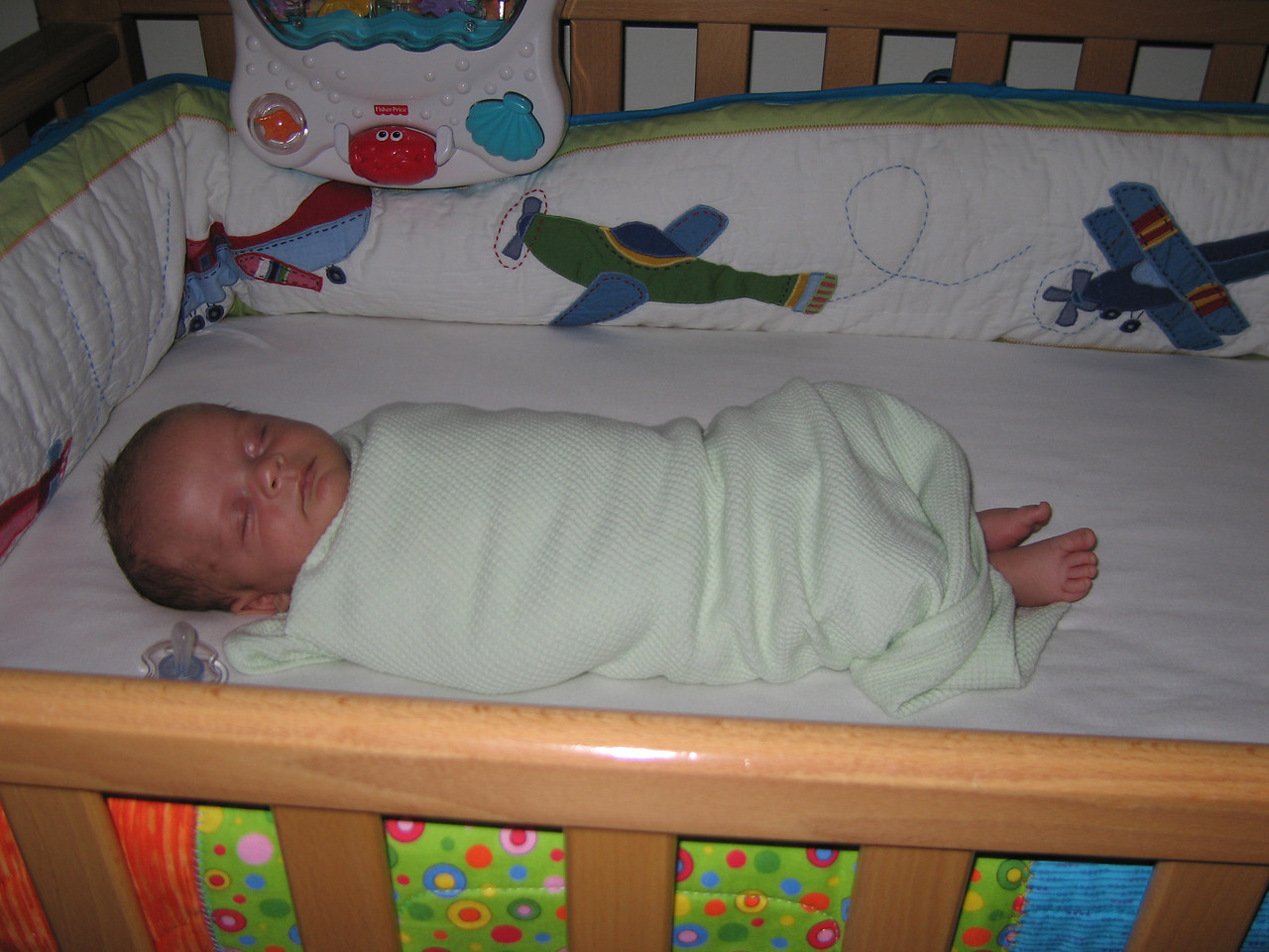 Asleep in his crib