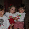 Sam, Reese, and Jake, all decked out in their Christmas shirts