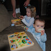 Puzzle playing...Reese now calls her old puzzles Owen's puzzles.  They are for babies, even though she still played with them 2 weeks ago.