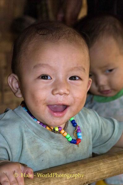 Laughing Paduang Baby Boy In Refugee Camp, Maehongson Thailand