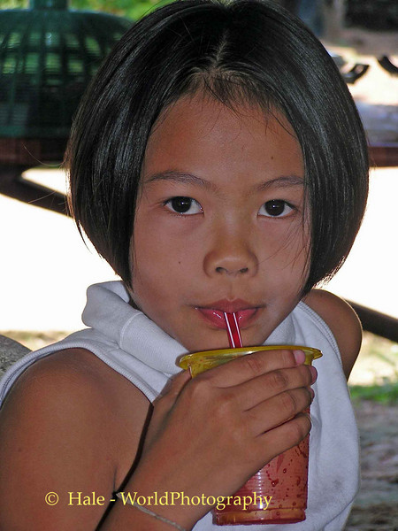 Young Lao Loum Girl Cooling Off On A Hot Isaan Afternoon - Tahsang Village Thailand