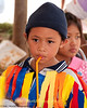 A Young Lao Loum School Boy Enjoys His Drink After Dancing