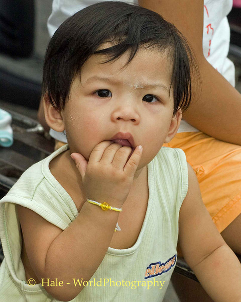 Young Toddler Watching The Parade, Phuket Thailand