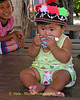 Lao Loum Infant Wearing Hill Tribe Hat - Tahsang Village Thailand