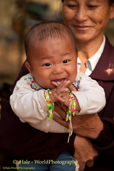 Young Hmong Baby Boy at New Year's Festival in Luang Prabang, Lao People's Democratic Republic