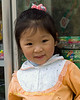 Young Girl Outside Her Mother's Film Store, Sapa Vietnam