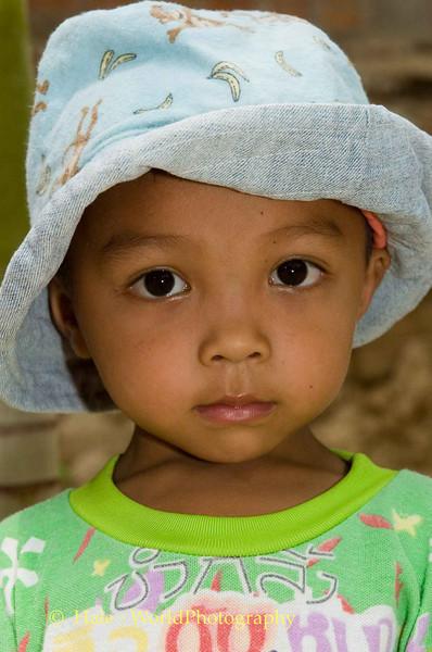 Lao Loum Bot Wearing Hat - Tahsang Village Thailand