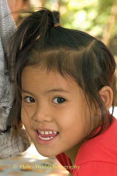 Lao Charmer Along the Bank of the Mekong,
