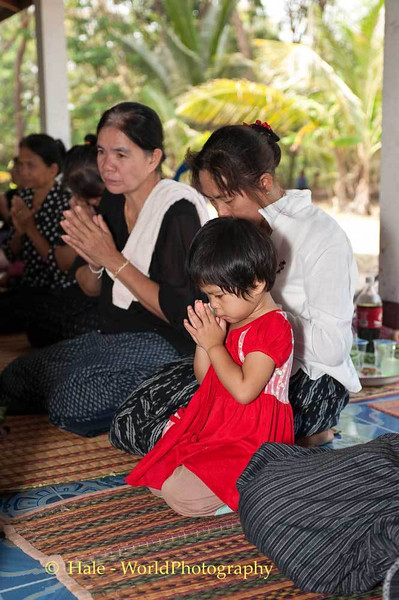 A Young Lao Loum Girl Participates In Funeral Ritaul In Northease Thailand