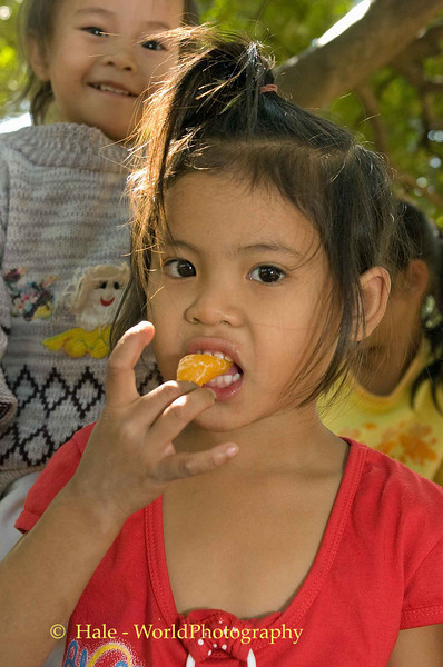 Lao Child Eating Fruit, Vientiane Laos