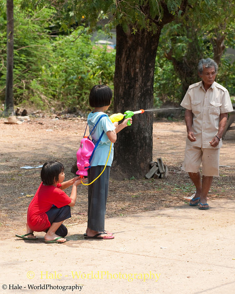 Young Girls Fire A Squirt Gun For Songkran