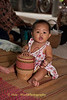 Lao Loum Baby Plays During Buddhist Merit Making Ritual