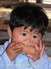 Kwan Enjoying a Snack, Tahsang Village Thailand