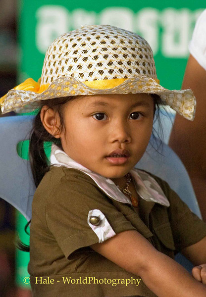 Young Girl Wearing Hat Outside of Wat Sothon, Thailand