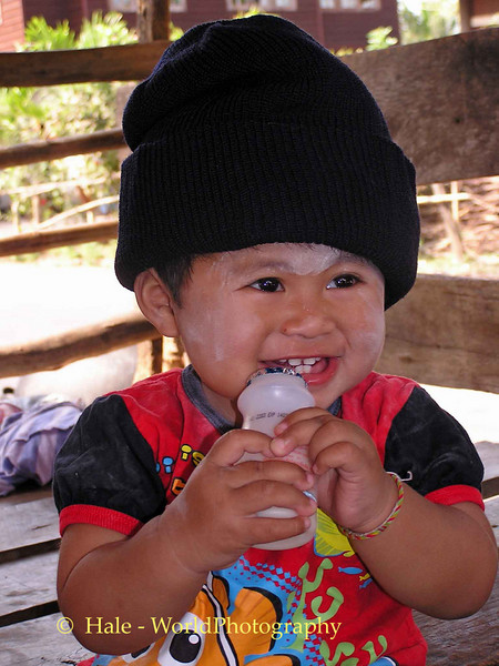 Baby Kwan Enjoying Fermented Milk Drink After Her Bath, Tahsang Village, Isaan Thailand