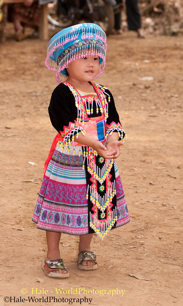Young Hmong Girl in Traditional Clothing at New Year's Festival in Luang Prabang Prepares to Catch A Ball, Lao People's Democratic Republic