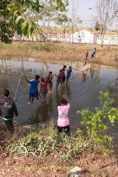 Students Crossing Water During Scout Day