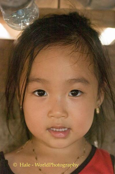 Young Girl at Fruit Stand, Quan Lan Island Vietnam