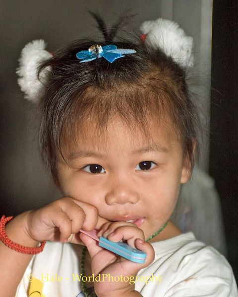 Young Girl in Bangrak Market, Bangkok Thailand