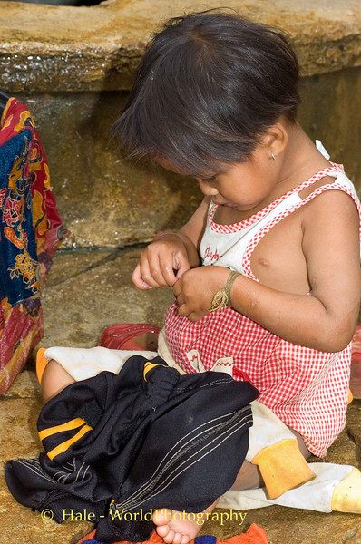 Helping Mom Wash Clothes in Lahu Village on the Road to Pai, Thailand
