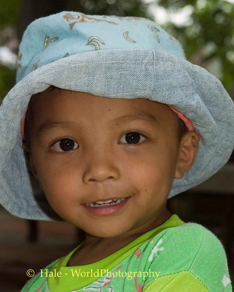 Lao Loum Young Boy with Hat - Tahsang Village, Isaan Region Thailand